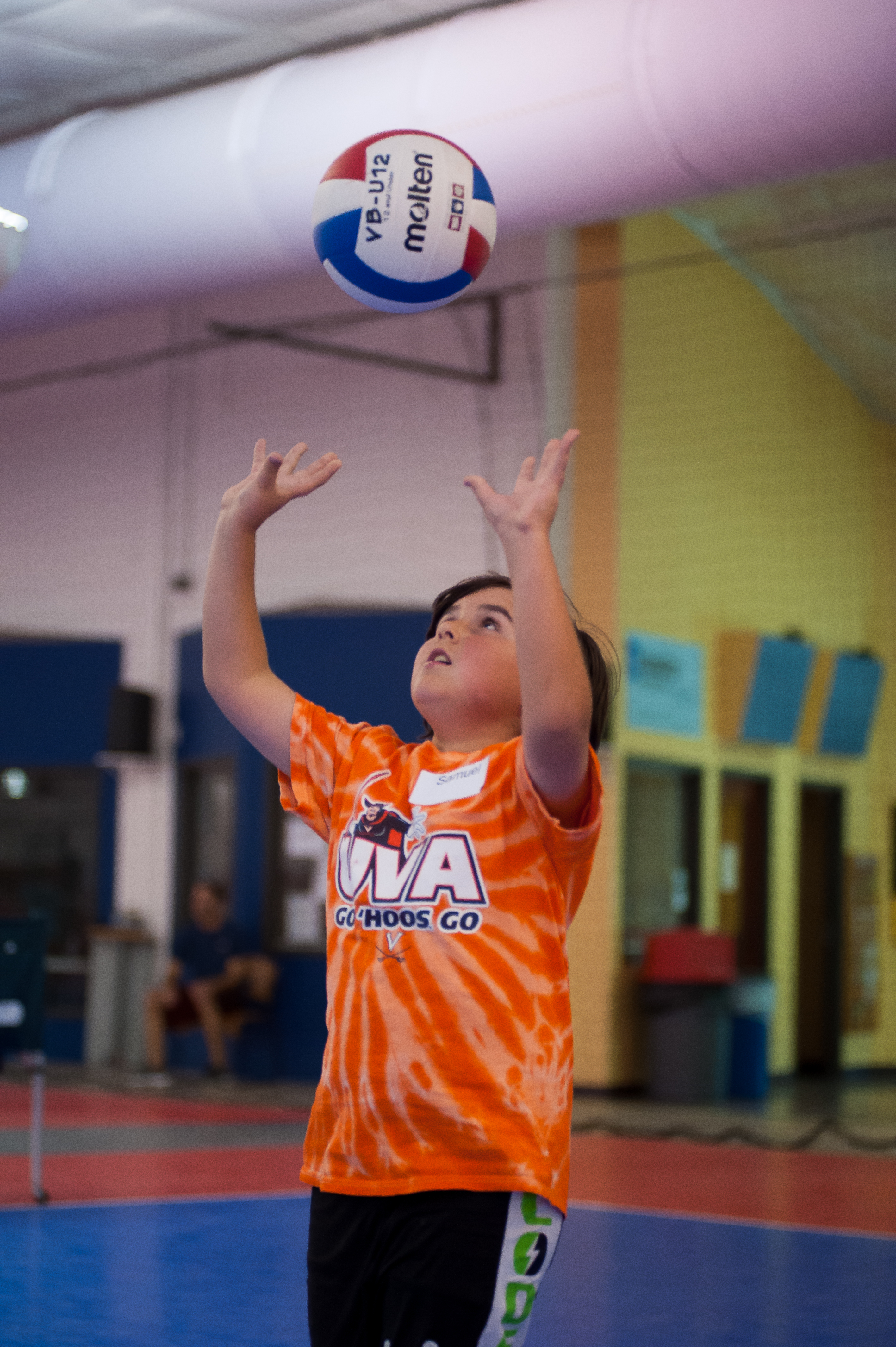 Jumpin Junior player setting the ball during kids volleyball practice
