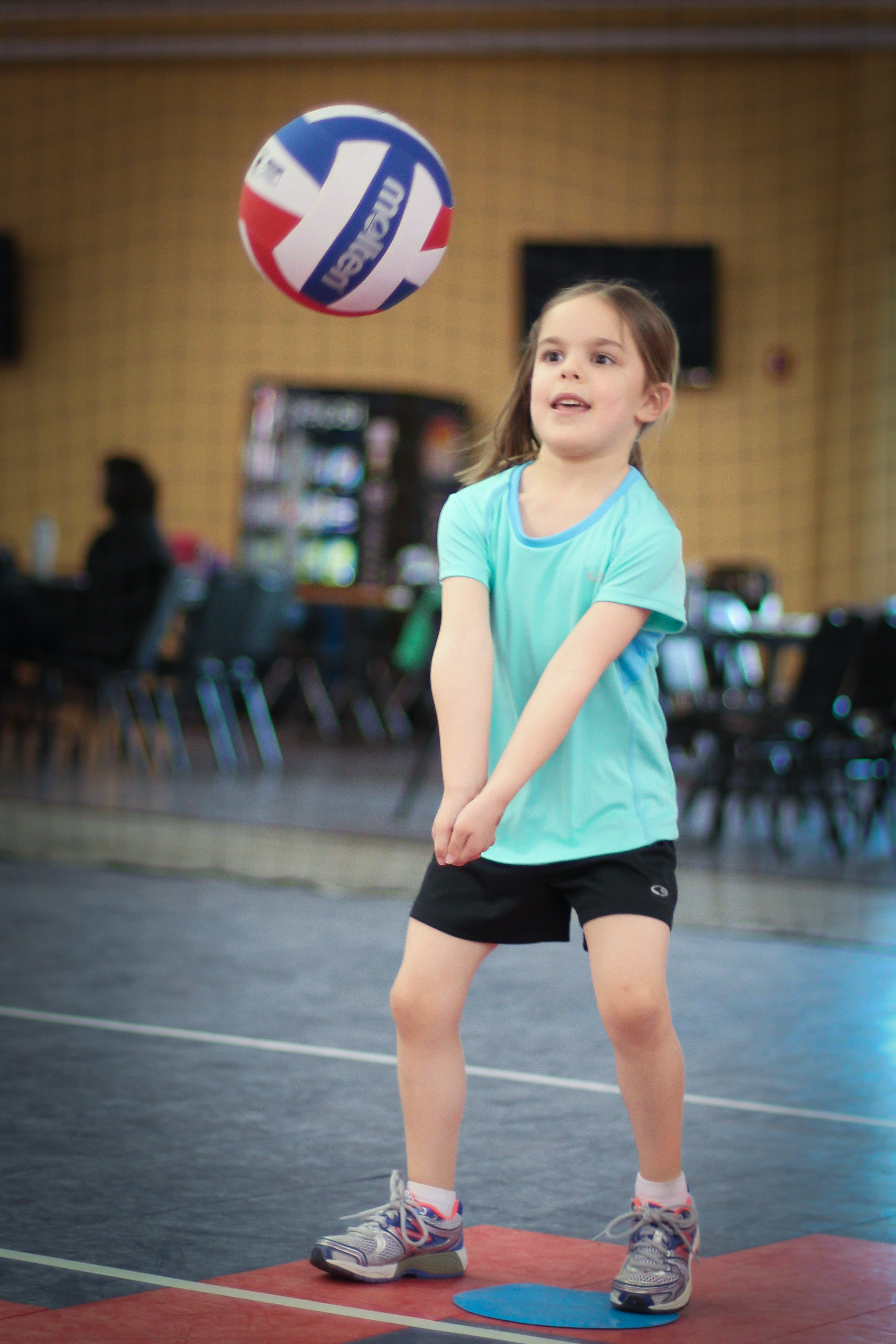 Preschooler passing a volleyball during Itsy Bitsy Spikers at Richmond Volleyball Club
