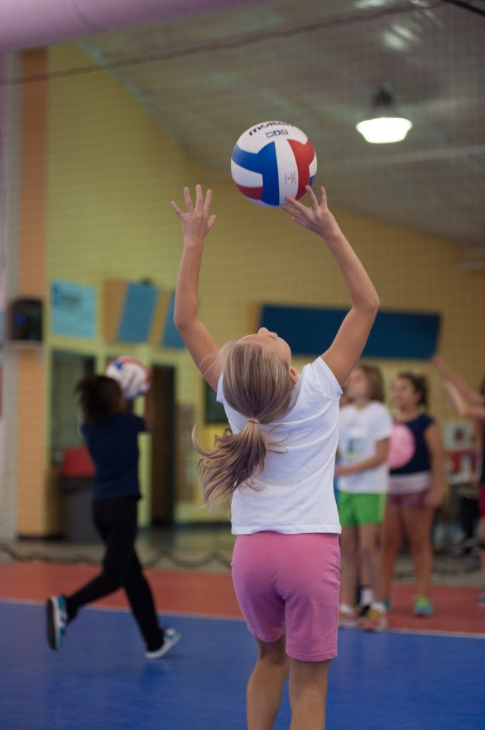Middle School League 5th - 6th Grade Volleyball girl setting a volleyball