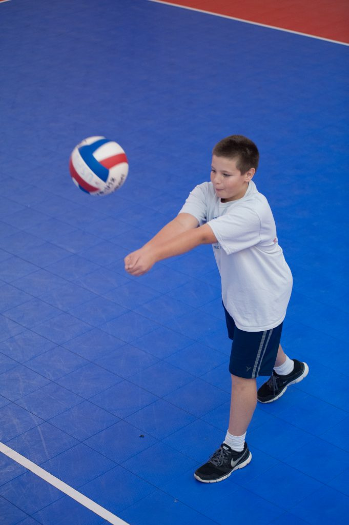 Middle School League 5th - 6th Grade Volleyball boy passing a volleyball