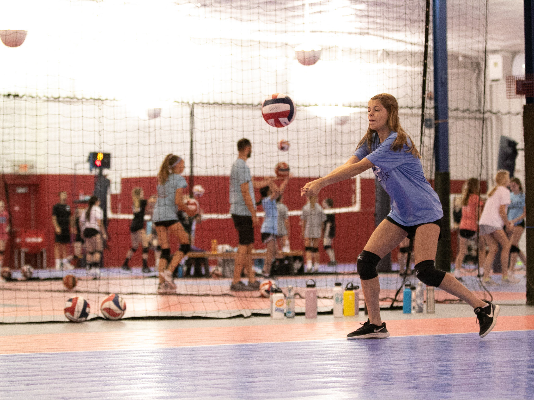Richmond Volleyball Club summer camps player passing a volleyball