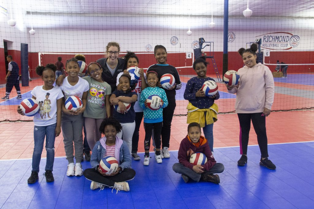 Group of Richmond Police Athletic League athletes with a Richmond Volleyball Coach at a volleyball camp hosted by Richmond Volleyball Club in May 2019