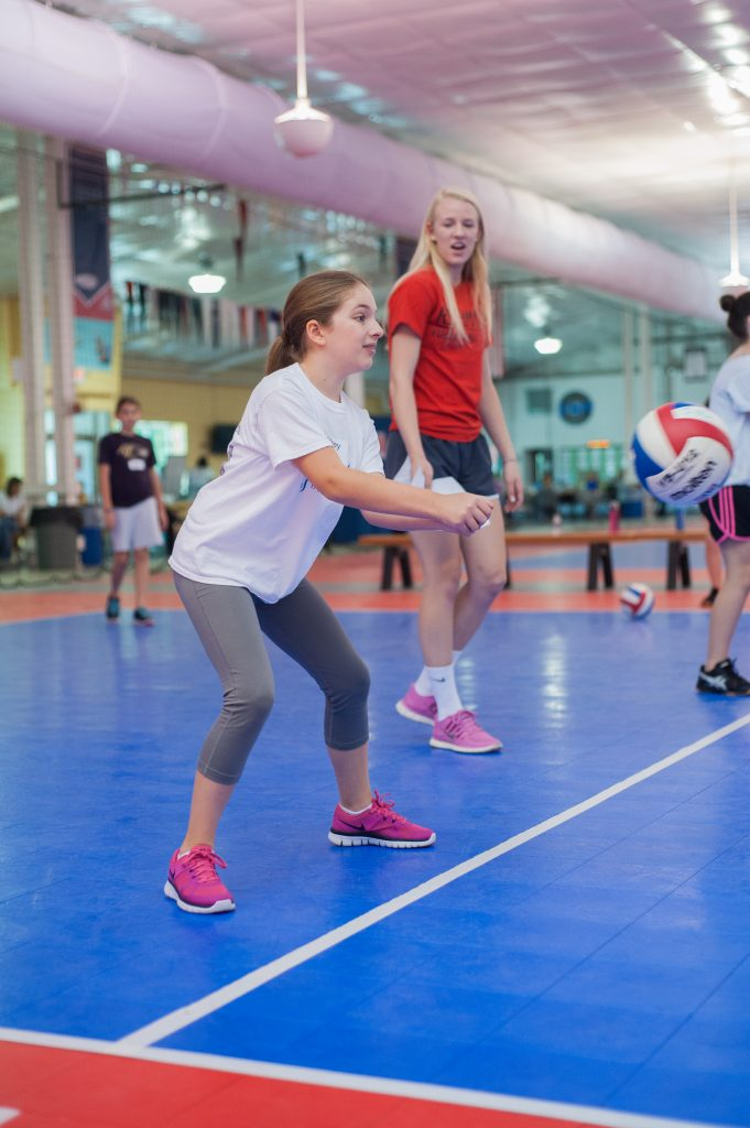Jumpin Junior player passing the ball during kids volleyball practice